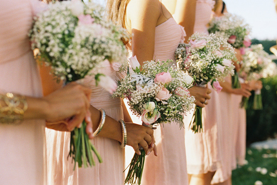 bridesmaids wear pink dresses hold babies breath garden rose bouquets