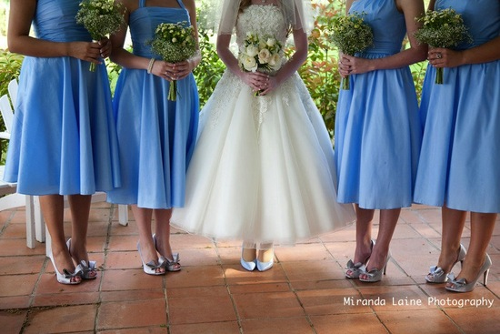 photo of secret garden wedding inspiration blue bridesmaids dresses tea length wedding dress
