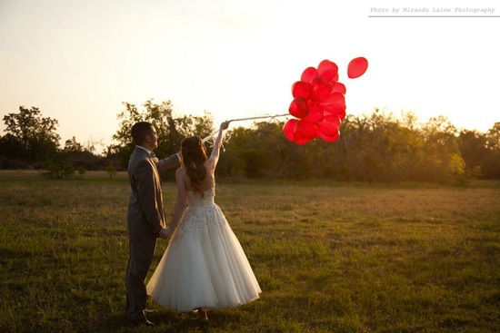photo of bride groom outside after wedding ceremony release balloons
