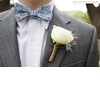 Groom-wears-blue-bow-tie-floral-print-grey-tailored-suit.square