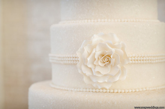 photo of classic ivory wedding cake pearl details