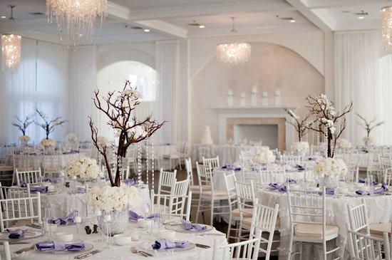 photo of ivory purple real wedding manzanita branch centerpieces