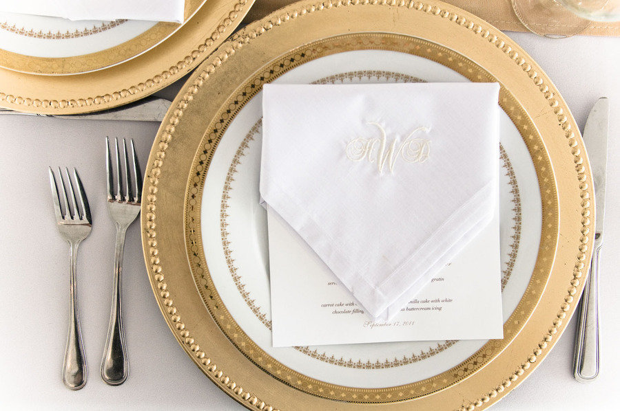 gold wedding reception place setting