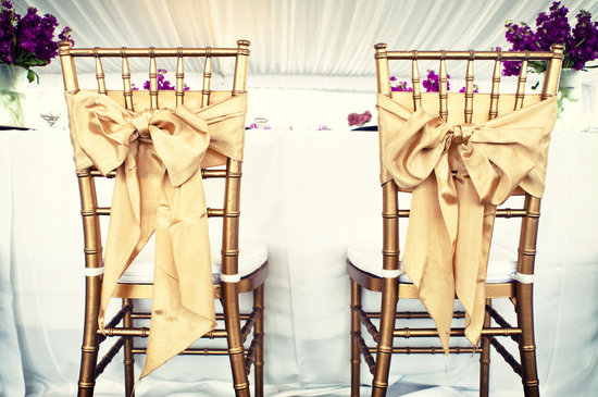elegant wedding reception bride groom chairs gold bows
