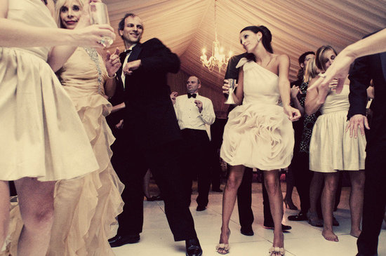 bride dances in little white dress at reception