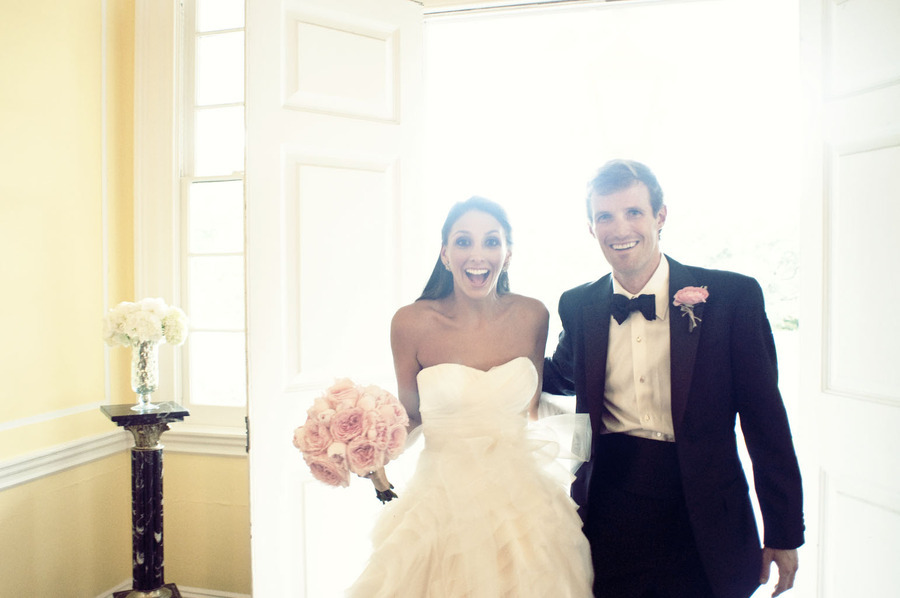 black tie bride and groom smiling after vows