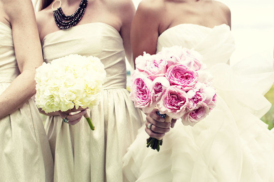 photo of Monochromatic wedding flower bouquets for the bride and her maids