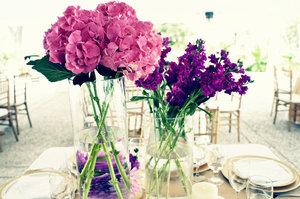 photo of Wedding flower inspiration in every color under the sun- pink and purple centerpieces
