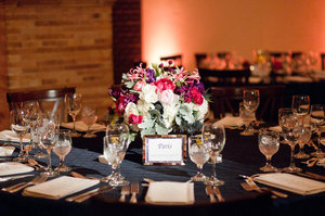 photo of bright wedding centerpieces reception tables themed after travel destinations