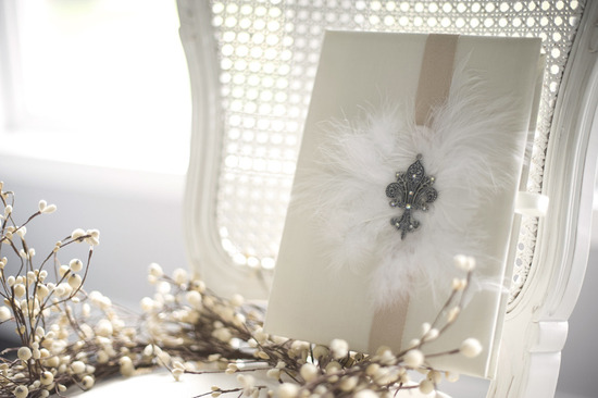 photo of winter wedding feather adorned wedding guest book