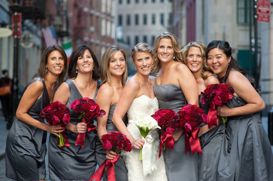 bride with bridesmaids in grey dresses deep red bouquets