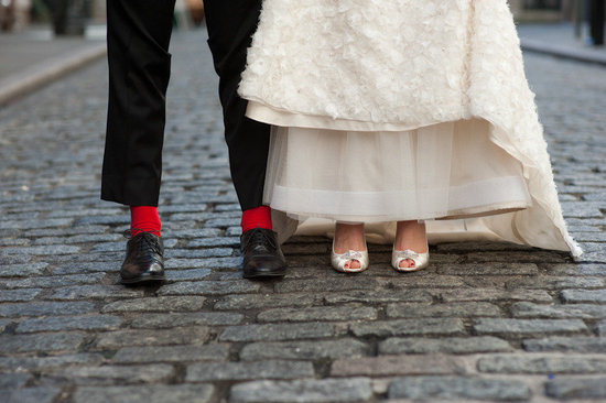 ivory wedding dress and peep toe bridal heels groom wears red socks