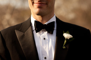 photo of black tie groom bow tie