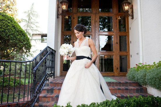 white vera wang wedding dress illusion neckline black sash