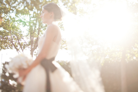 bride wears white vera wang ballgown black sash