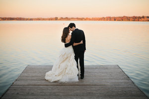 photo of artistic wedding photography outdoor wedding bride groom on dock