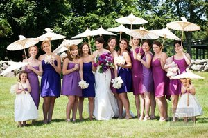 photo of purple mix and match bridesmaids