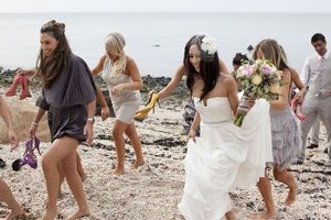 photo of low key beach wedding mix match bridesmaids