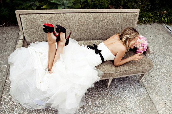 photo of brides accessorizing with black vera wang wedding dress black sash 2