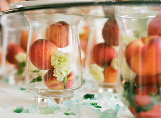 unique wedding centerpieces hurricane vases filled with peaches