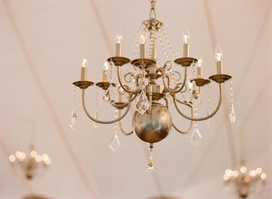 Elegant-real-wedding-outdoor-reception-under-tent-chandelier.full