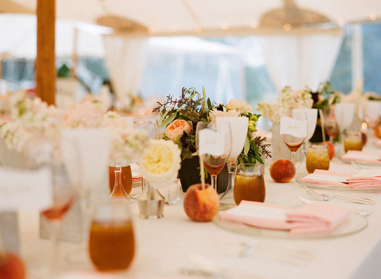 elegant real wedding outdoor reception under tent chic tablescape with peach details