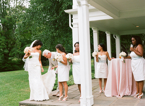 elegant real wedding outdoor reception under tent bride with her bridesmaids