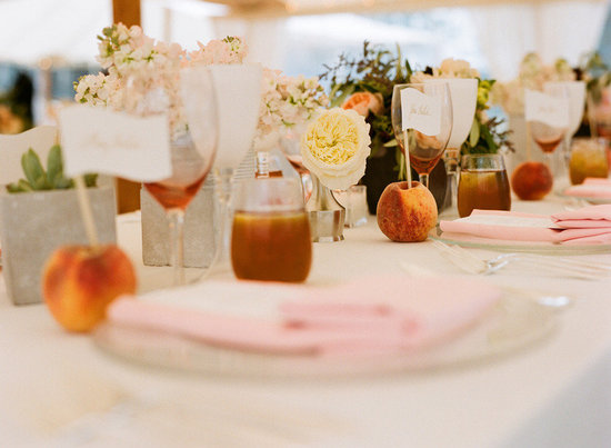 elegant real wedding outdoor reception under tent peach tablescape