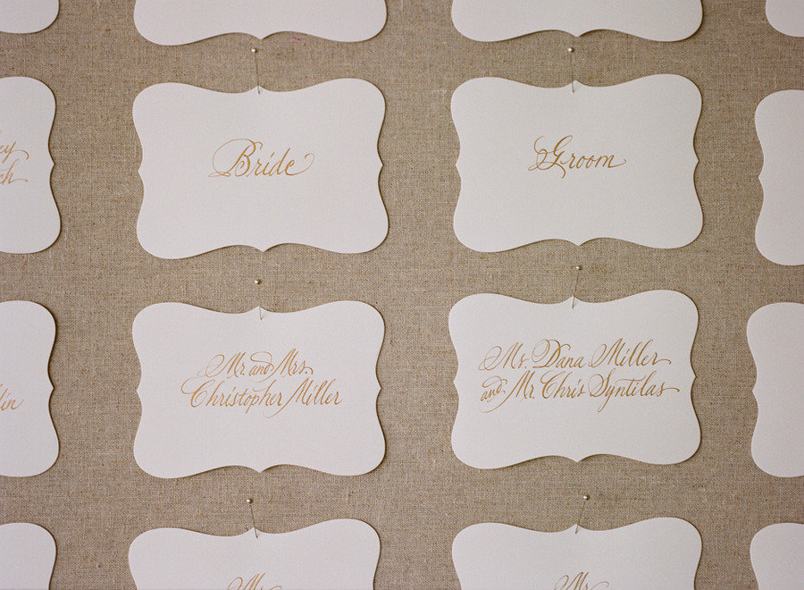 elegant real wedding outdoor reception under tent chic escort cards white gold