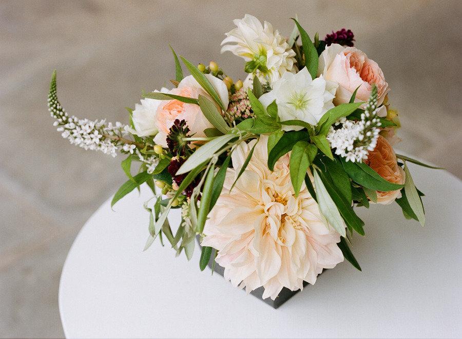 Elegant-real-wedding-outdoor-reception-under-tent-peach-green-ivory-centerpiece.full