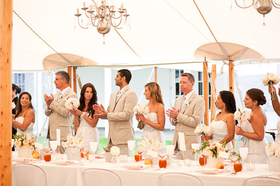 Elegant-real-wedding-outdoor-reception-under-tent-chandeliers-above.full