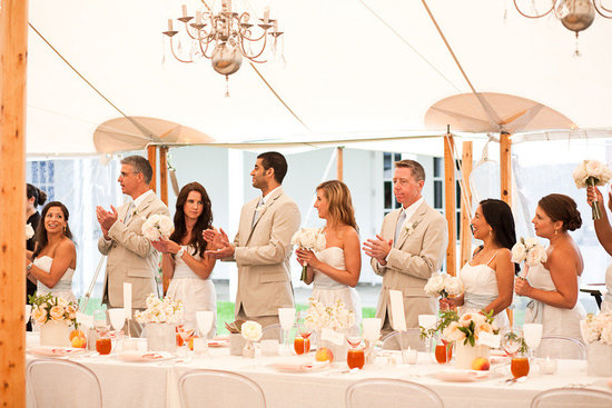 elegant real wedding outdoor reception under tent chandeliers above