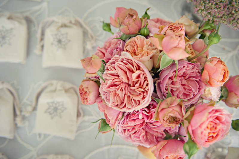 Elegant-real-wedding-outdoor-reception-under-tent-heavenly-peach-pink-wedding-flowers.full