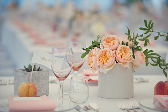 elegant real wedding outdoor reception under tent peach centerpieces
