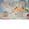 Elegant-real-wedding-outdoor-reception-under-tent-peach-centerpieces.square