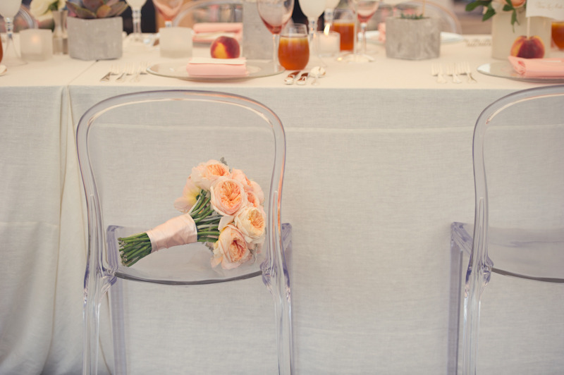 Elegant-real-wedding-outdoor-reception-under-tent-peach-bouquet-ghost-chairs.full