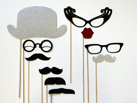 photo of Mad Men themed wedding photo booth props