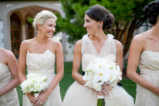 bride with bridesmaids outdoor romantic wedding twisted chignon