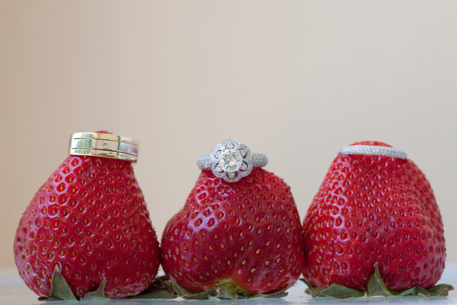 Engagement-ring-wedding-bands-photographed-on-strawberries.full