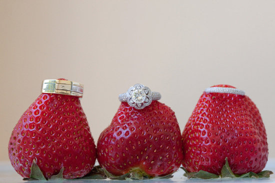 engagement ring wedding bands photographed on strawberries