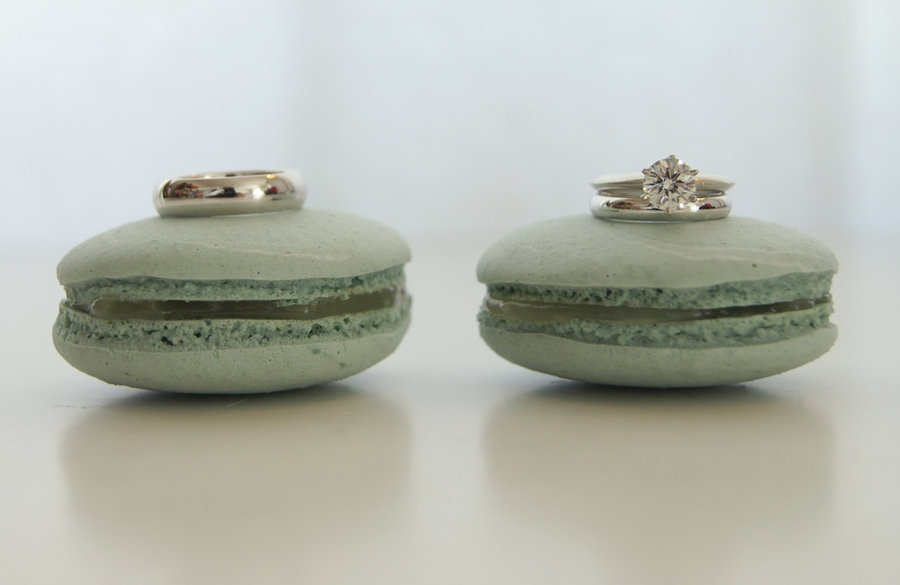 diamond engagement ring grooms wedding band shot on green macaroons
