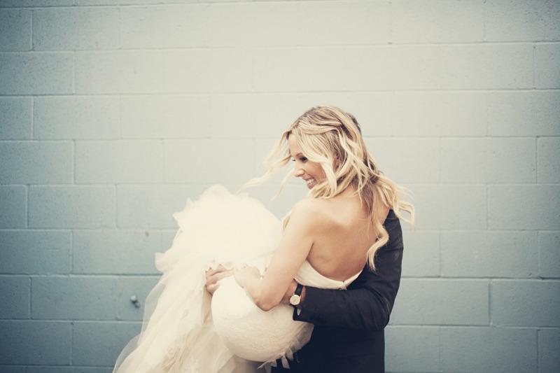 Groom-carries-bride-over-threshold.full