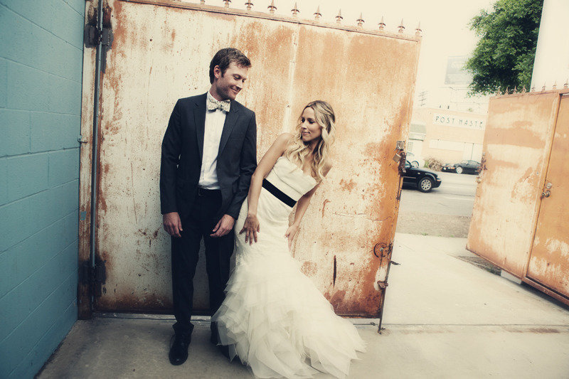 Bride-and-groom-pose-together-outside-la-wedding-venue.full