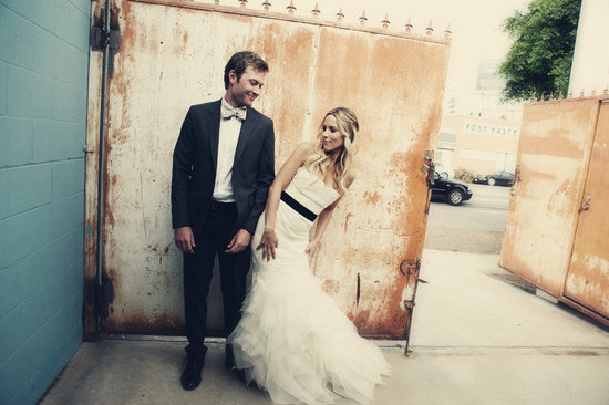 bride and groom pose together outside LA wedding venue
