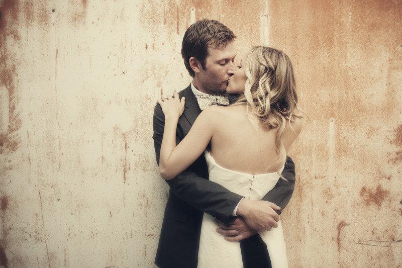 All-down-wedding-hair-loose-waves-bride-groom-kiss.full