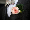 Groom-wears-patterned-bow-tie-charcoal-grey-suit.square