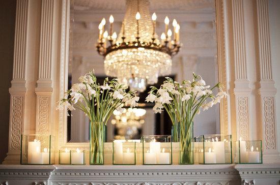 photo of elegant wedding reception venue ivory wedding flowers candles