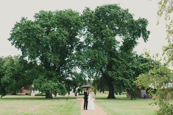 green wedding inspiration bride groom kiss under tree