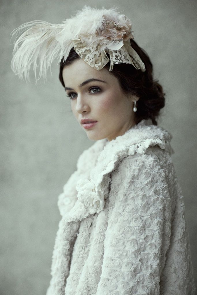 photo of romantic bridal accessories winter wedding fur cape feather hair piece