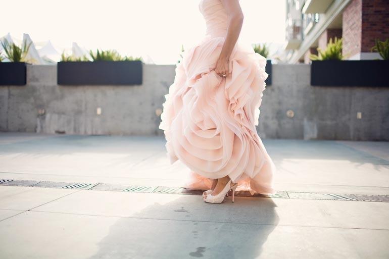 Bride-wears-pink-vera-wang-wedding-dress-shows-off-wedding-shoes.full